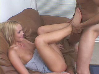 Pretty-faced and sexy blonde hardening horny dick with her foot